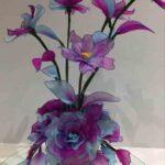 Kék-rózsaszín virágkompozíció